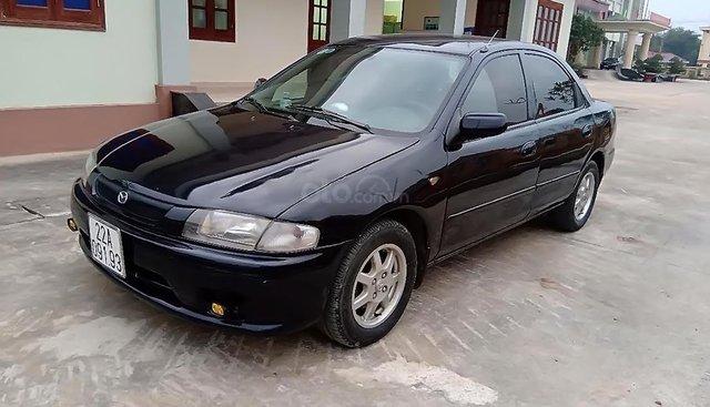 Bán Mazda 323 2000, còn tương đối nguyên bản, màu xanh đen quyền lực