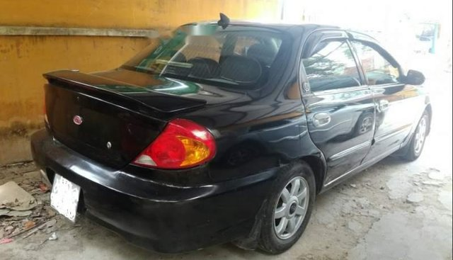 Gia đình bán xe Kia Spectra sản xuất 2003, màu đen