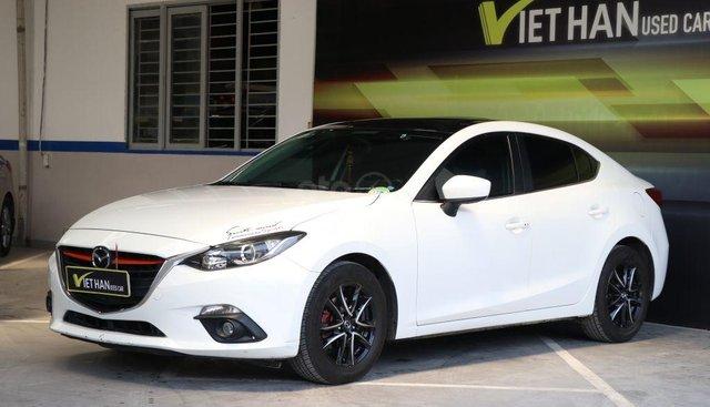 Cần bán xe Mazda 3 1.5AT năm 2015, màu trắng