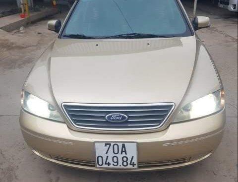 Cần bán xe Ford Mondeo 2.5 đời 2004, màu vàng, xe nhập chính chủ