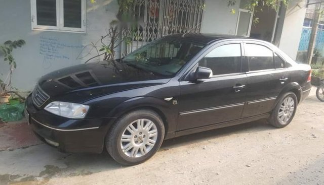 Cần bán lại xe Ford Mondeo 2004, màu đen, máy êm, điều hòa rét run