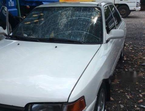 Bán ô tô Mazda 323 đời 1995, màu trắng, nhập khẩu xe gia đình, giá chỉ 63 triệu