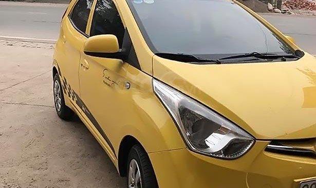 Cần bán gấp Hyundai Eon đời 2012, màu vàng, nhập khẩu, Đk lần đầu 2014