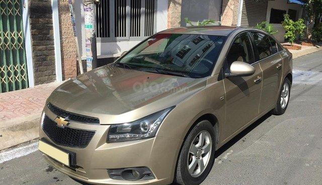 Bán Chevrolet Cruze LS 2011 số sàn ,màu vàng cát, gia đình chính chủ