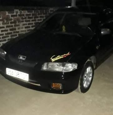 Bán Mazda 323 đời 2001, màu đen giá cạnh tranh