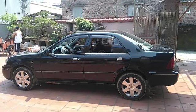 Gia đình bán Ford Laser GHIA 1.8 MT đời 2003, màu đen