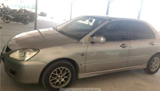Cần bán Mitsubishi Lancer GLX 1.6 AT sản xuất 2004, xe gia đình đang sử dụng chạy êm tốt