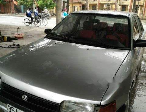 Bán Mazda 323 năm sản xuất 1997, màu bạc, nhập khẩu nguyên chiếc
