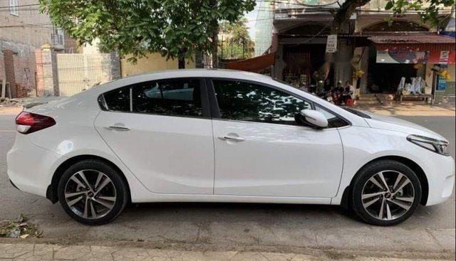 Cần bán gấp Kia K3 2.0 đời 2016, màu trắng