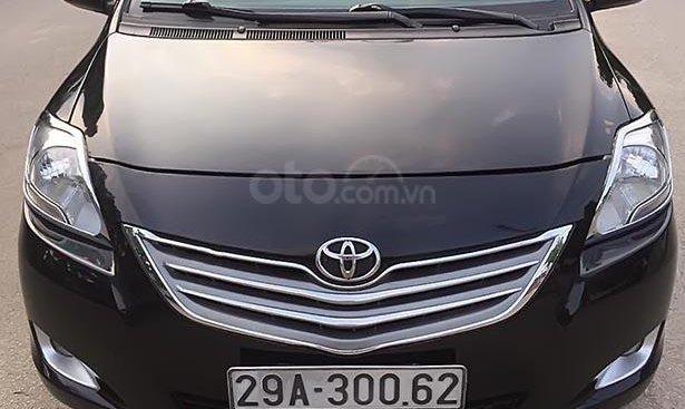 Bán xe Toyota Vios 1.5E đời 2011, màu đen, xe gia đình