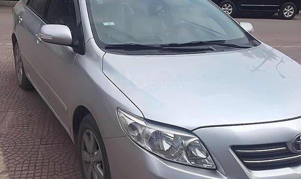 Cần bán Toyota Corolla altis 1.8G AT đời 2010, màu bạc