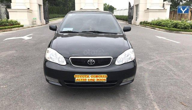 Cần bán xe Toyota Corolla altis 1.8G đời 2003, màu đen. Chính chủ cực chất lượng