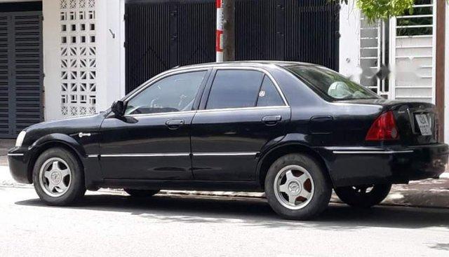 Chính chủ bán Ford Laser sản xuất 2003, màu xanh đen