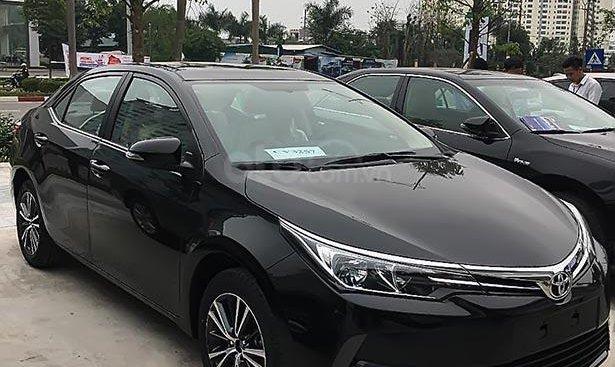 Cần bán xe Toyota Corolla altis 1.8G AT năm 2019, màu đen
