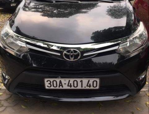 Cần bán lại xe Toyota Vios 2014, màu đen số sàn