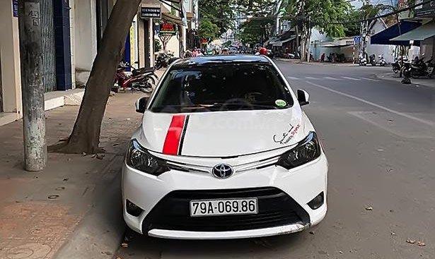 Bán Toyota Vios 1.5E đời 2014, màu trắng số sàn