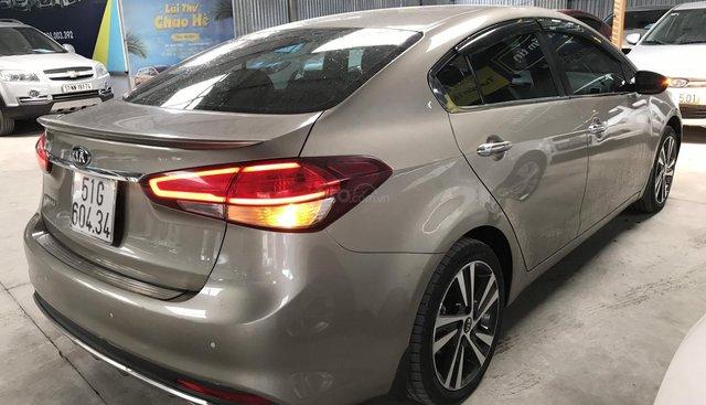 Bán Kia Cerato 1.6AT màu vàng cát, số tự động, sản xuất 2018, biển Sài Gòn, xe như mới