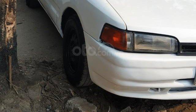 Bán ô tô Mazda 323 sản xuất năm 1996, màu trắng, xe nhập