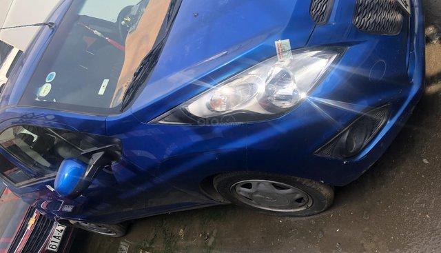 Ngân hàng thanh lý xe Chevrolet Spark 2017 LT màu xanh