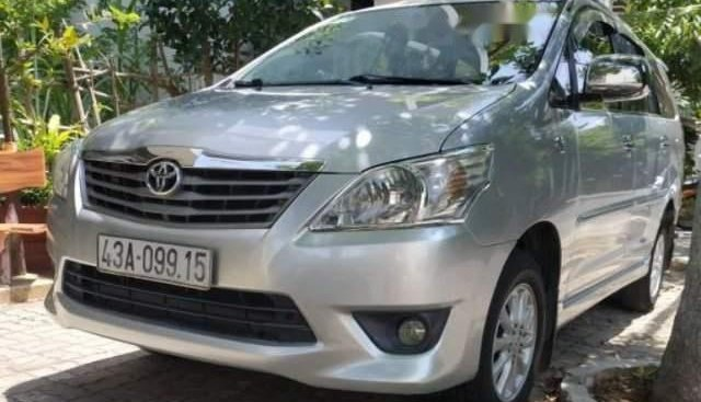 Gia đình bán Toyota Innova E đời 2013, màu bạc