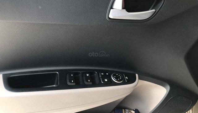 Bán Hyundai Grand i10 sedan 1.2MT màu nâu titan, số sàn, bản đủ, sản xuất 2018