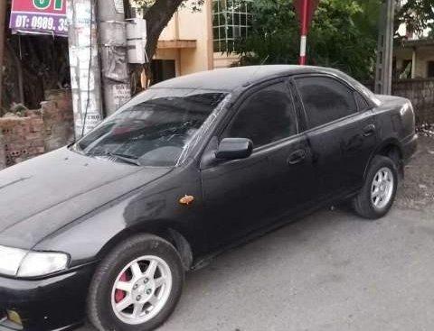 Bán xe Mazda 323 năm sản xuất 1997, màu đen, xe nhập, 95tr