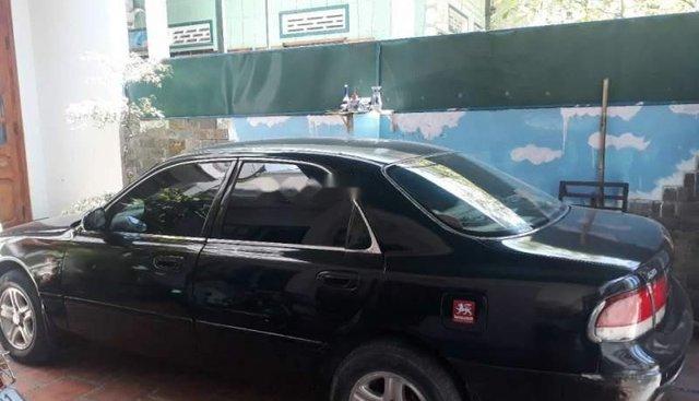 Bán Mazda 626 năm sản xuất 1992, màu đen, nhập khẩu nguyên chiếc số sàn, giá chỉ 100 triệu