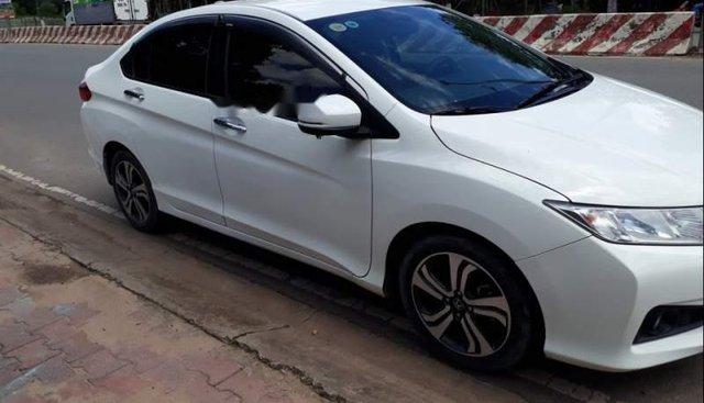 Cần bán xe Honda City đời 2016, màu trắng, Đk 12/2016, còn sổ bảo dưỡng đầy đủ