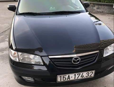 Bán Mazda 626 sản xuất năm 2001, màu đen, xe vừa bọc lại da nội thất