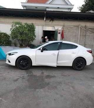 Bán ô tô Mazda 3 1.5 FL năm sản xuất 2017, màu trắng, xe nhập, thắng tay điện tử