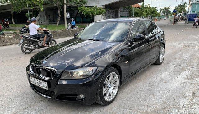 BMW 3 Series 320i đời 2010, màu đen nội thất kem