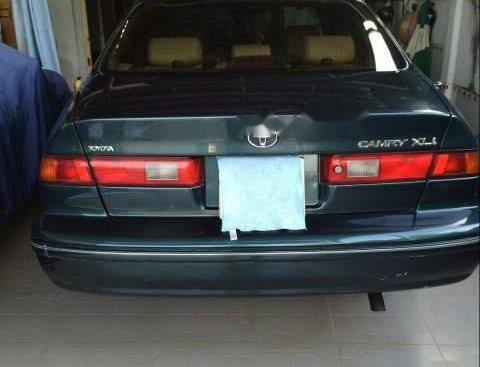 Bán lại xe Toyota Camry năm 2000, màu xanh dưa