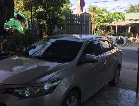 Cần bán xe Toyota Vios E 1.5 năm 2015, màu vàng cát