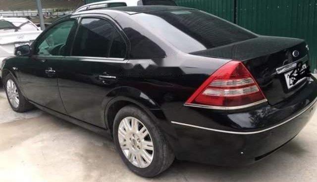 Bán lại xe Ford Mondeo 2.5 đời 2003, màu đen như mới