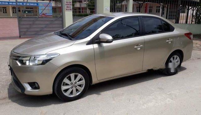 Cần bán gấp Toyota Vios E 2014, màu vàng xe gia đình, giá tốt