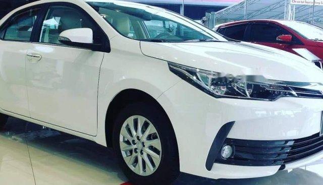 Bán Toyota Corolla altis sản xuất năm 2019, màu trắng, giá tốt