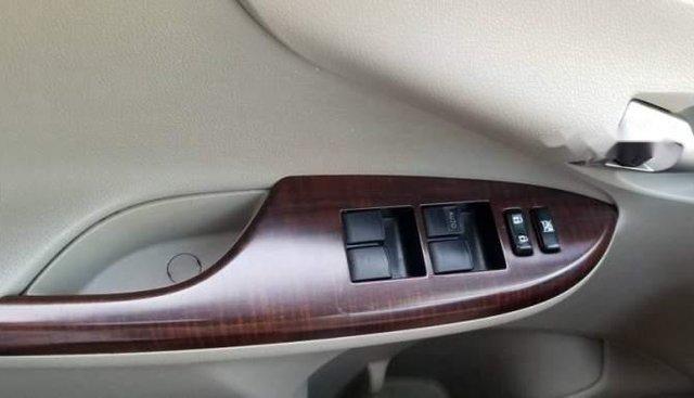 Gia đình bán xe Toyota Corolla Altis 1.8G AT sản xuất cuối 2010, màu đen