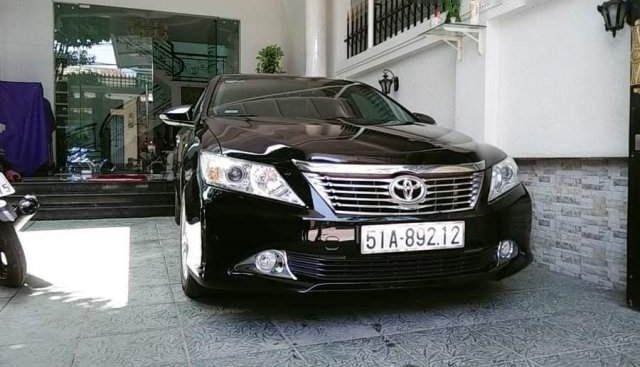 Chính chủ bán Camry 2.5Q full option, sản xuất 2014, màu đen sang trọng, odo 38000km