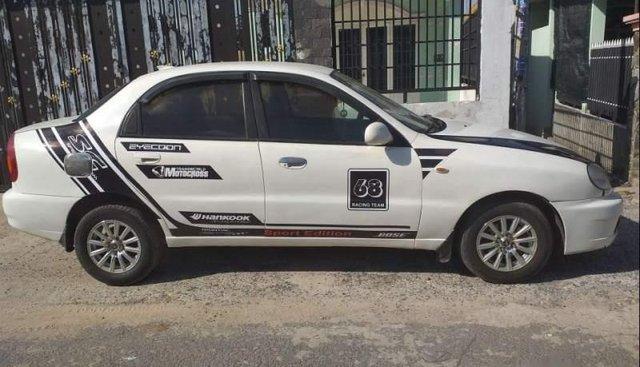 Cần bán lại xe Daewoo Lanos sản xuất năm 2003, màu trắng, nhập khẩu, mâm đúc đồ chơi