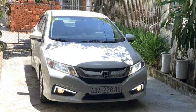 Bán lại xe Honda City màu trắng, số tự động, đã đi 28000km, đăng ký 10/2016