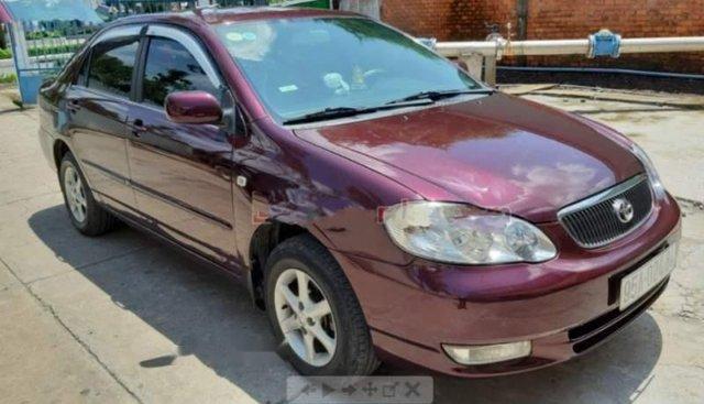 Bán xe Corolla Altis 1.8 MT 2002, số sàn, màu đỏ đô quý phái, gầm bệ chắc chắn