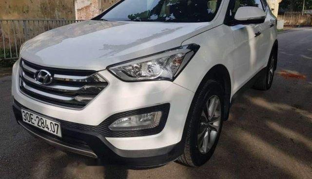Cần bán Hyundai Santa Fe 2.2 máy dầu, màu trắng Sx 2015, xe tư nhân chính chủ