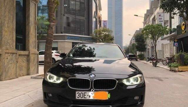 Bán BMW 320i sản xuất 2013, màu đen, nhập khẩu