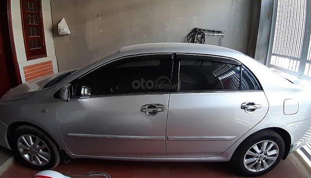 Bán Toyota Corolla altis 1.8E AT sản xuất năm 2010, màu bạc