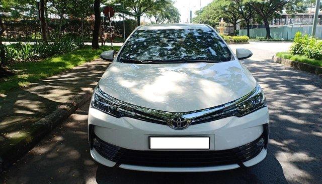 Bán Toyota Altis 1.8G năm 2018, màu trắng, xe sử dụng rất ít, bán 740tr