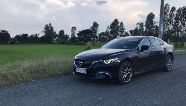 Bán Mazda 6 2018, màu đen, xe mới chính chủ, đang sử dụng tốt