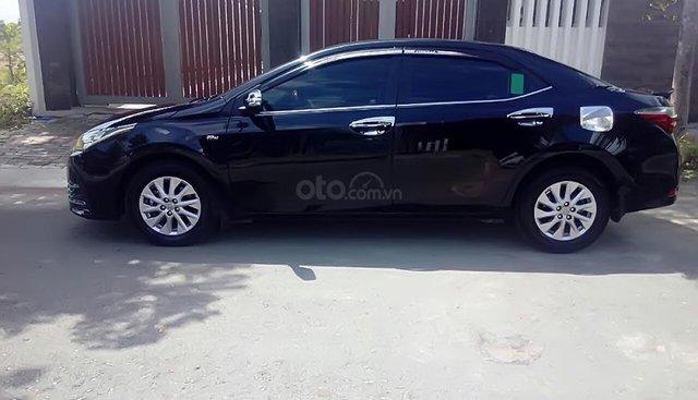 Cần bán lại xe Toyota Corolla Altis đời 2017, màu đen số tự động