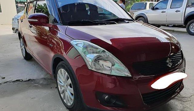 Cần bán Suzuki Swift AT đời 2015, màu đỏ chính chủ giá cạnh tranh