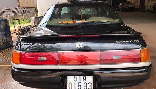 Bán xe Toyota Carina màu đen, đời 1991