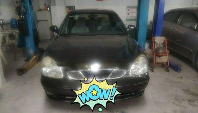Cần bán lại xe Daewoo Nubira 2.0 đời 2000, màu đen xe gia đình